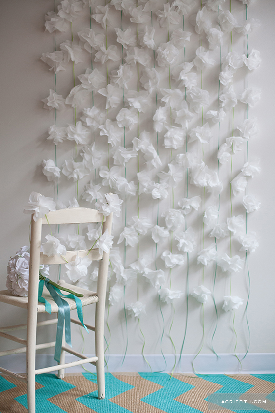 Cocktail napkin flower party backdrop