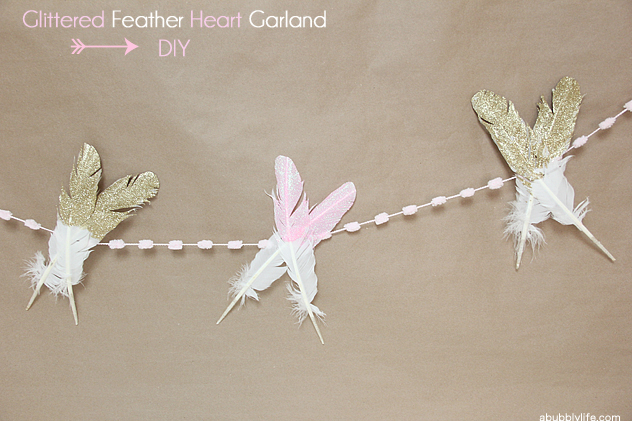 DIY glitter feather garland photo booth backdrop
