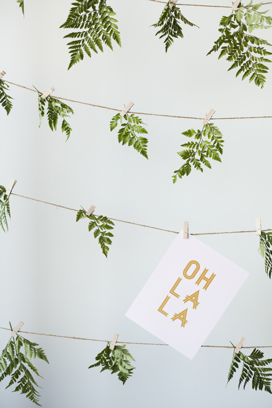 Natural photo booth backdrop made with leaves