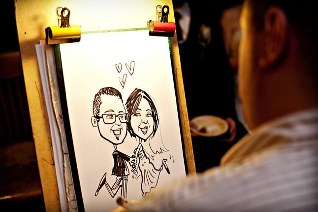 Caricature artist drawing couple at dinner and dance