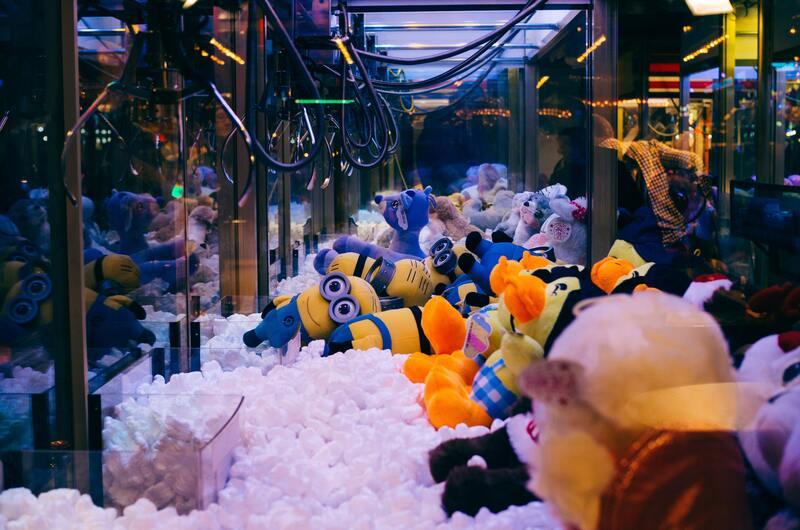 Claw machine with Minion soft toys as prizes