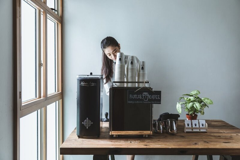Female barista serving coffee at a coffee cart