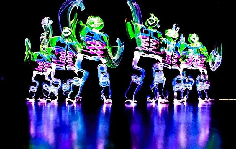 Dancers wearing LED costumes performing at a dinner and dance