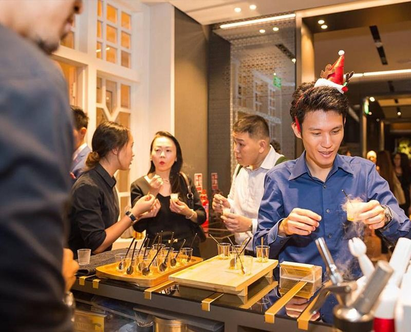 Man taking drinks from mobile bar at a dinner and dance