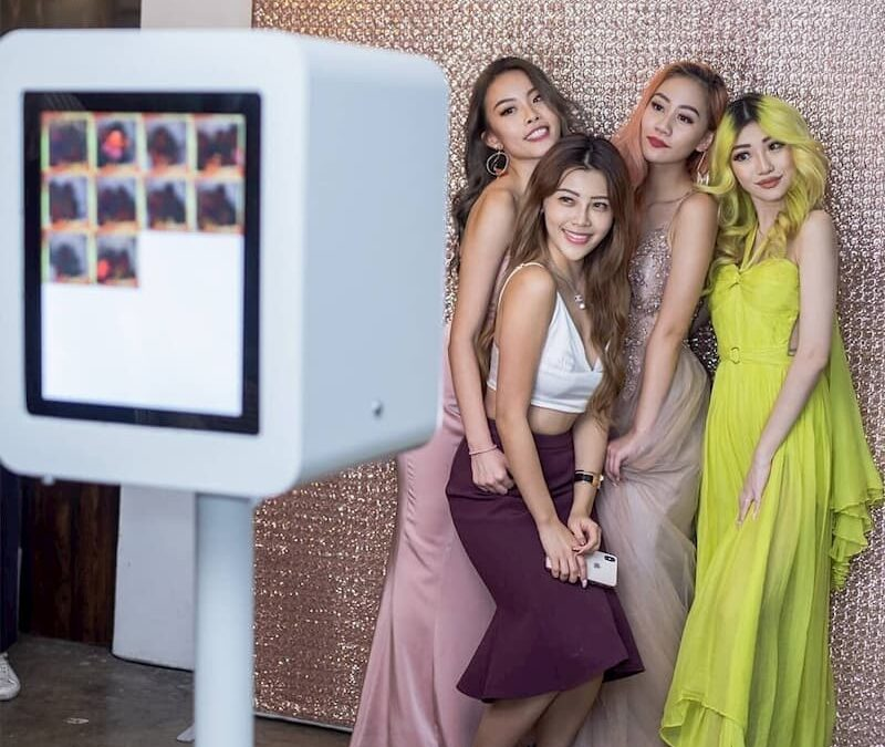 Group of girls posing at photo booth