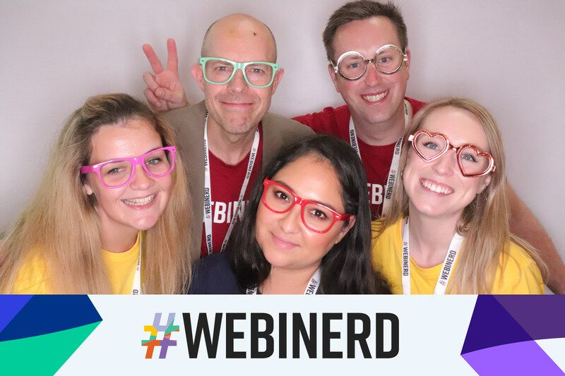 Friends posing at photo booth with nerd glasses at conference show