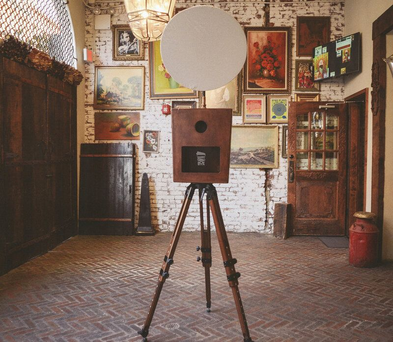 Retro or vintage style photo booth with wood exterior