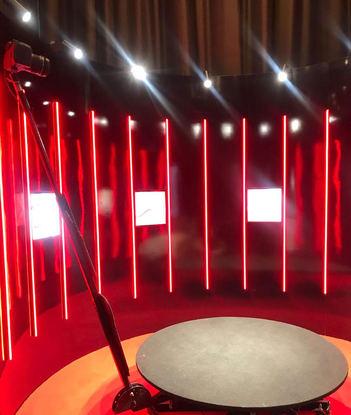 Revolving photo booth with lighting setup