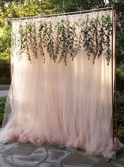 Pink curtain backdrop for photo booth