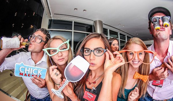 Group of friends posing at fisheye photo booth