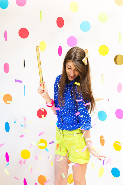 Woman posing at floating confetti photo booth