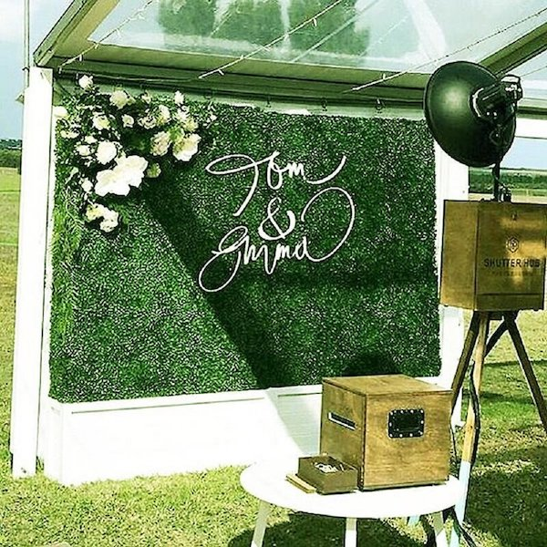 Green wall photo booth