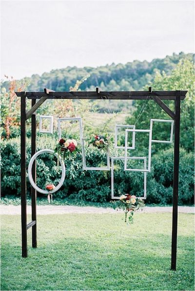 Photo booth with multiple hanging photo frames