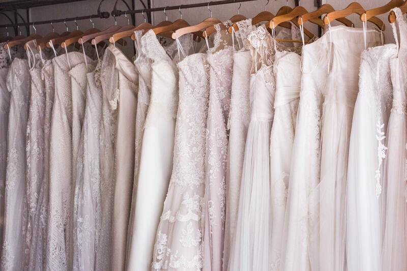 Rack of pink and white wedding dresses