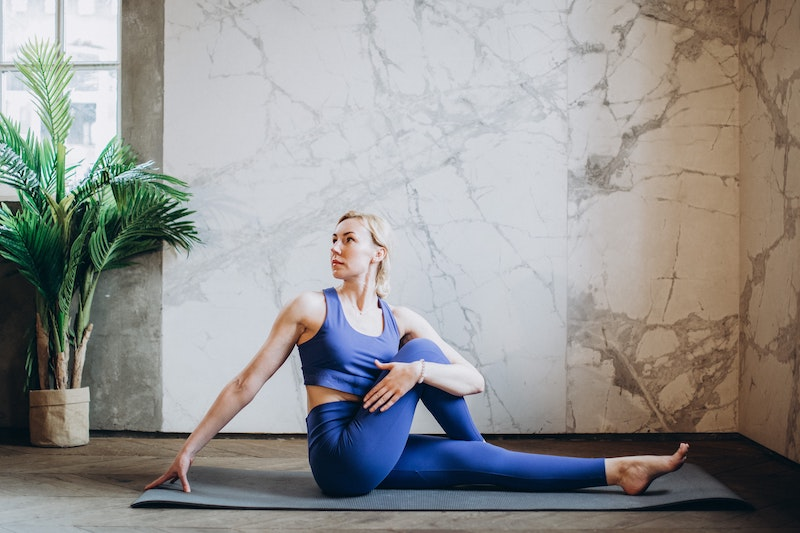 Instructor teaching yoga class at online event
