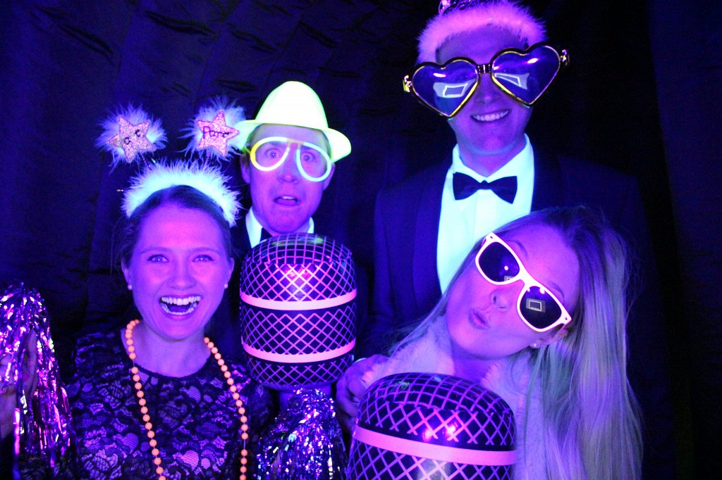 People posing with neon lights and reflective clothing in neon photobooth uv light photoshoot night dark