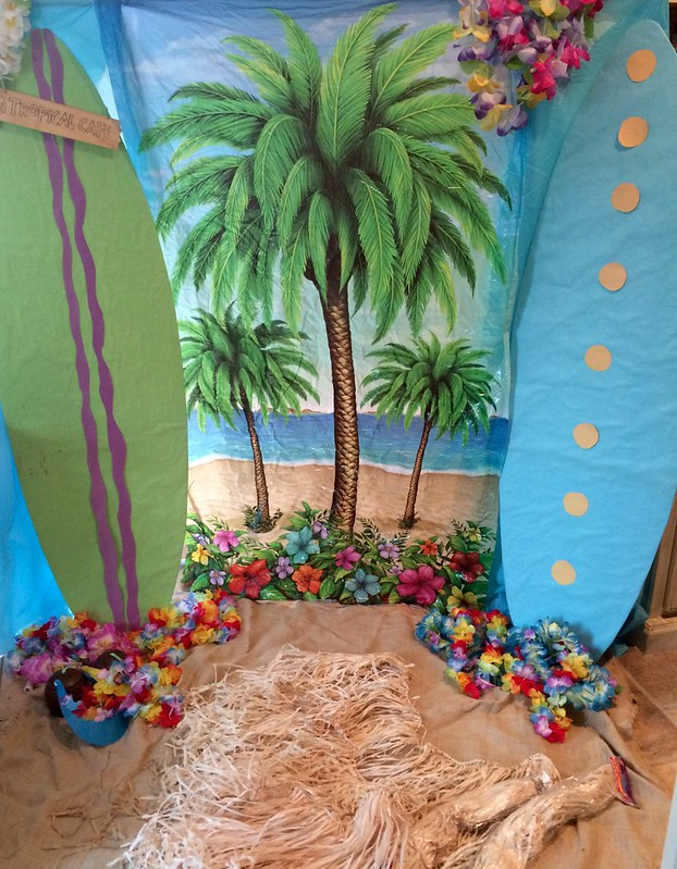 DIY Beach style backdrop with palm trees flowers surfboards for photoshoot tropical photobooth background