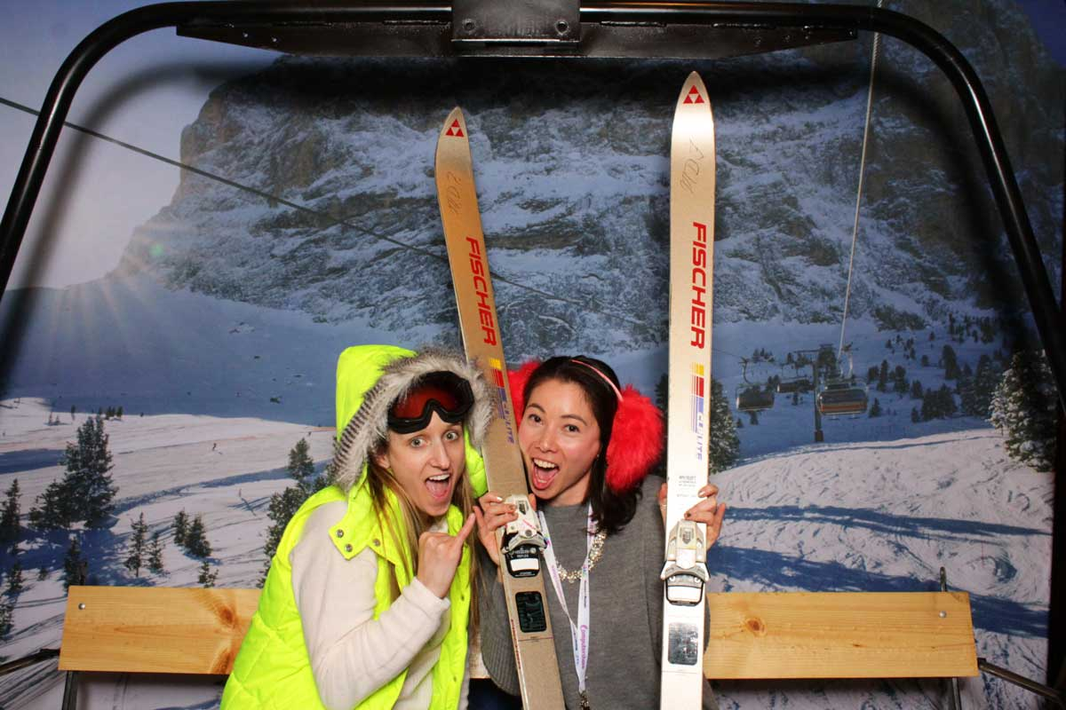 People posing for photo ski lift outfit theme winter sports event photoshoot promotion photobooth