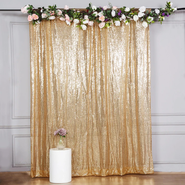 Golden Backdrop with flowers hung DIY for photobooth photoshoot for wedding event