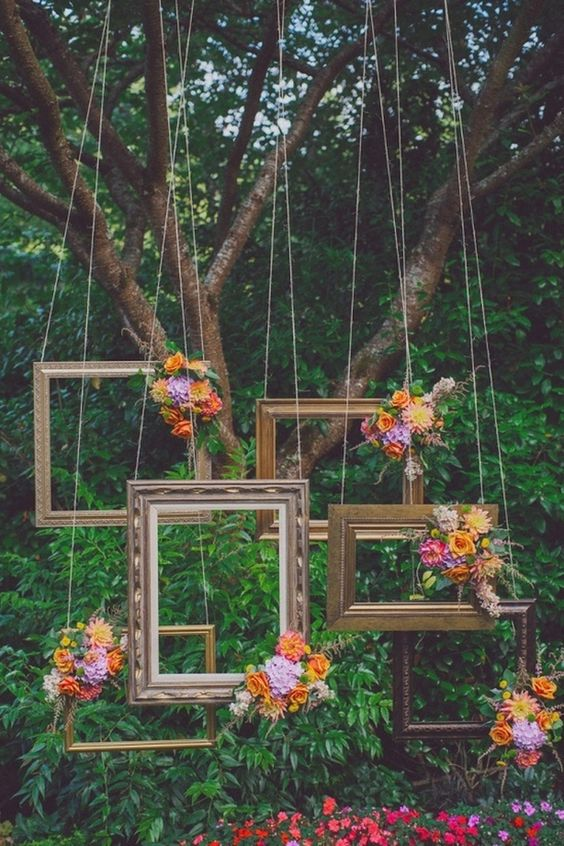 Frames hanging from a tree for backdrop photoshoot photobooth wedding