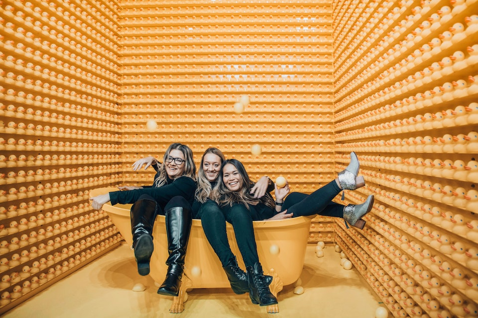 Photo booth installation with 3 women posing for photo