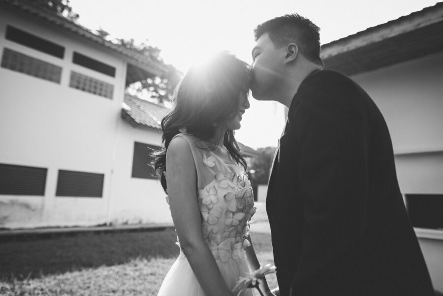 Couple kissing on their pre-wedding photoshoot event photography wedding outdoor venue