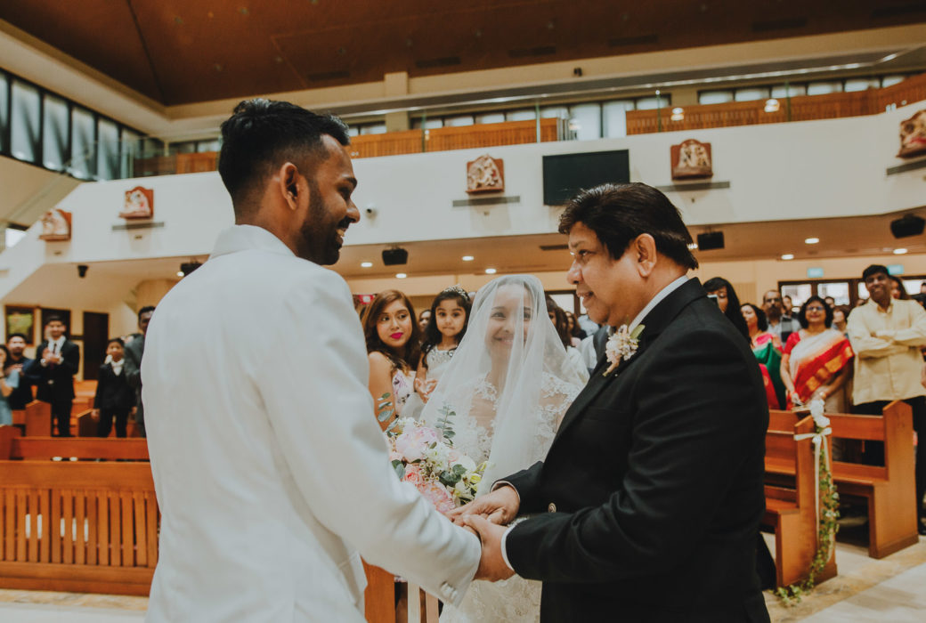 Bride meeting Groom at the front of the stage wedding photography ceremony photograph