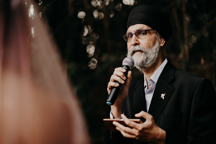 Wedding Officiant addressing the couple at a wedding photograph photography event
