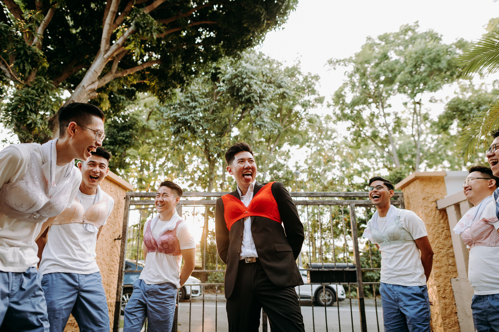 Groomsmen participating in games having memorable time photography photographer wedding event