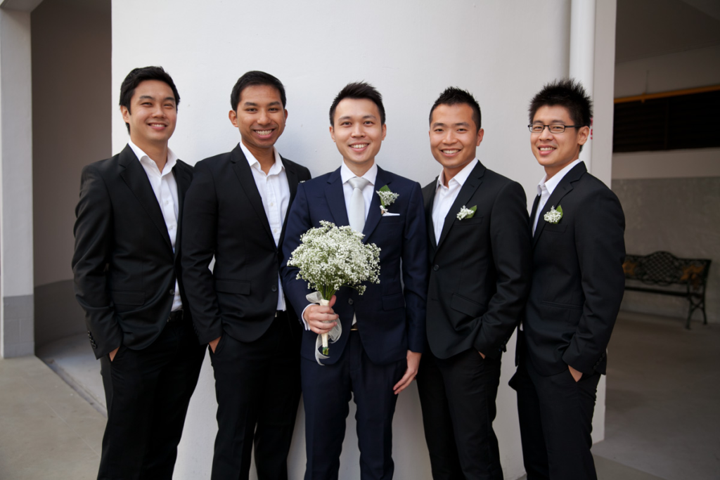 Groom and Groomsmen having photograph together by photographer wedding photography