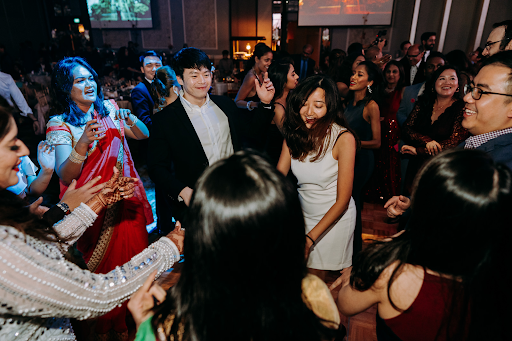 Wedding guests interacting with each other on wedding ceremony mingling event photograph photography
