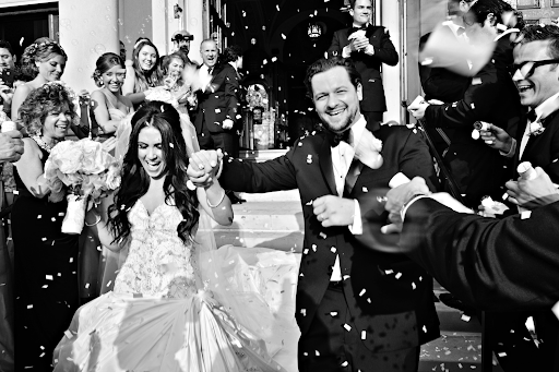 Couple celebrating ceremony at their wedding photograph photography