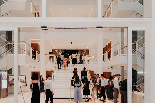 Wedding venue at the entrance with guests walking around the venue wedding photography photograph