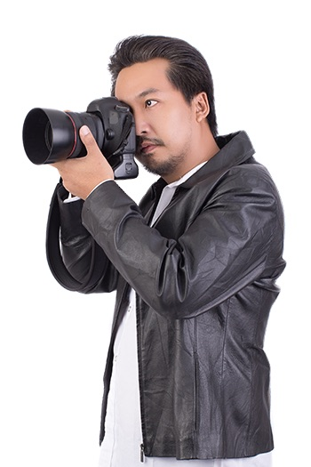 Professional event photographer holding DSLR