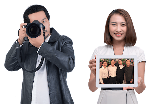 Professional wedding photographer holding DSLR and assistant holding tablet